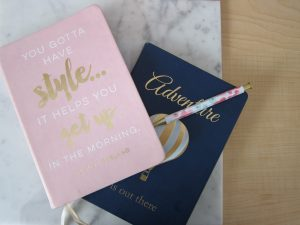 two journals and a pen